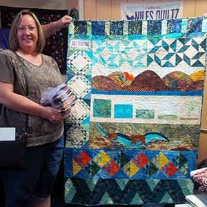 RBR winner Cindy Delumen with her quilt 2
