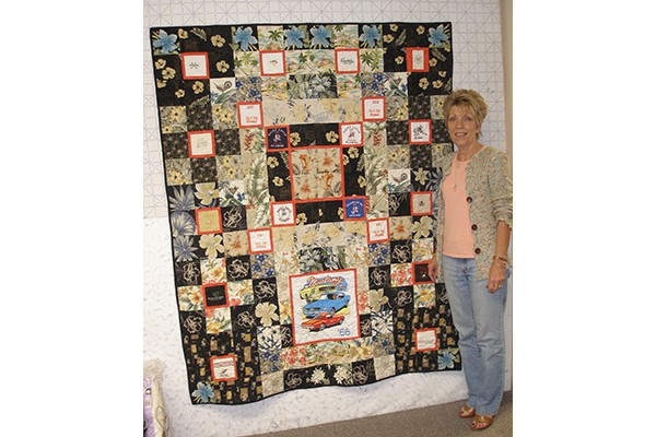 Marika G. with husband's quilt b
