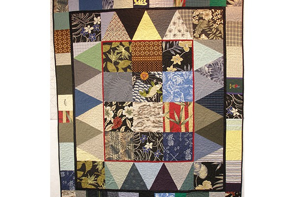 Quilt made from husband's shirts b